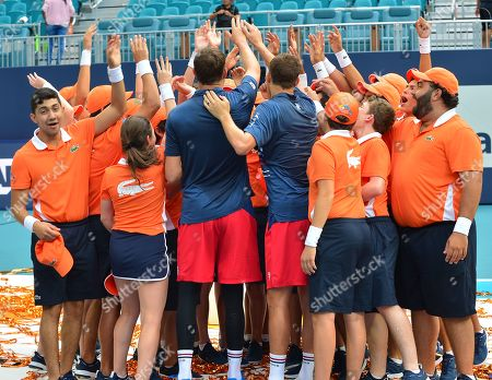 Bob Bryan and Mike Bryan, of USA hold the winners trophy after defeating Wesley Koolhof of Netherlands and Stefanos Tsitsipas of Greece at the doubles final