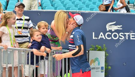 Bob Bryan of USA kiss his wife after defeating Wesley Koolh of of Netherlands and Stefanos Tsitsipas of Greece at the doubles final