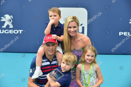 """Bob Bryan of USA pose for picture with his families Micaela Bryan, Michelle Bryan, Richard """"Richie"""" Charles Bryan and Bobby Bryan Jr, after defeating Wesley Koolhof of Netherlands and Stefanos Tsitsipas of Greece at the doubles final"""