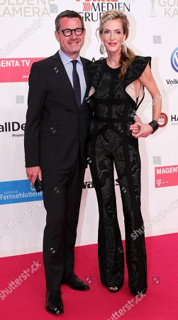 German journalist Kai Diekmann and his wife Katja Kessler arrive for the 54rd annual 'Goldene Kamera' (Golden Camera) film and television award ceremony in Berlin, Germany, 30 March 2019.