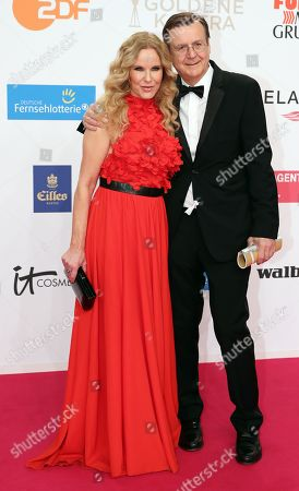Hans Mahr and Katja Burghard (L) arrive for the 54th annual 'Goldene Kamera' (Golden Camera) film and television awards ceremony in Berlin, Germany, 30 March 2019.