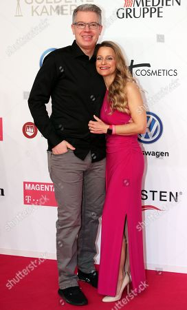 Stock Image of German entrepreneur Frank Thelen and his wife Nathalie arrive for the 54th annual 'Goldene Kamera' (Golden Camera) film and television awards ceremony in Berlin, Germany, 30 March 2019.