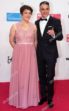 Stock Photo of Kostja Ullmann and guest arrive for the 54th annual 'Goldene Kamera' (Golden Camera) film and television award ceremony in Berlin, Germany, 30 March 2019.