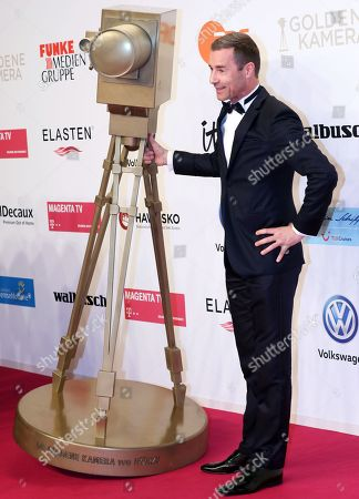 German TV moderator Kai Pflaume arrives for the 54th annual 'Goldene Kamera' (Golden Camera) film and television awards ceremony in Berlin, Germany, 30 March 2019.
