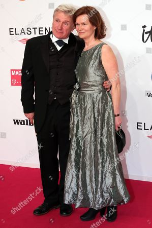 Joerg Schuettauf and his wife Martina Beeck arrive for the 54rd annual 'Goldene Kamera' (Golden Camera) film and television award ceremony in Berlin, Germany, 30 March 2019.