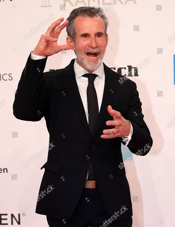 Ulrich Matthes arrives for the 54rd annual 'Goldene Kamera' (Golden Camera) film and television award ceremony in Berlin, Germany, 30 March 2019.