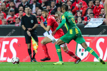 Benfica's Adel Taarabt (L) fights for the ball with Tondela's Patrick Fernandes during their Portuguese First League Soccer match at Luz Stadium in Lisbon, Portugal, 30 March 2019.