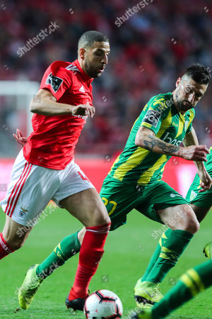 Benfica's Adel Taarabt (L) fights for the ball with Tondelas Bruno Monteiro during their Portuguese First League Soccer match at Luz Stadium in Lisbon, Portugal, 30 March 2019.