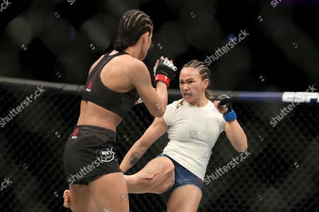 Michelle Waterson, right, lands a kick against Karolina Kowalkiewicz during their mixed martial arts bout at UFC Fight Night, in Philadelphia. Waterson won via decision