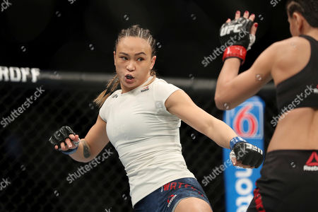 Michelle Waterson, left, in action against Karolina Kowalkiewicz during their mixed martial arts bout at UFC Fight Night, in Philadelphia. Waterson won via decision