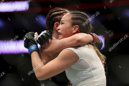 Michelle Waterson, right, hugs Karolina Kowalkiewicz after their mixed martial arts bout at UFC Fight Night, in Philadelphia. Waterson won via decision