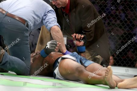 Michael Johnson is tended to by doctors after being KO'd by Josh Emmett in their mixed martial arts bout at UFC Fight Night, in Philadelphia. Emmett won via 3rd round KO