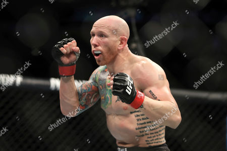 Josh Emmett in action against Michael Johnson during their mixed martial arts bout at UFC Fight Night, in Philadelphia