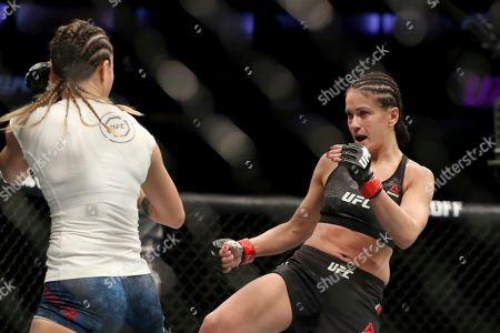 Karolina Kowalkiewicz, right, in action against Michelle Waterson during their mixed martial arts bout at UFC Fight Night, in Philadelphia