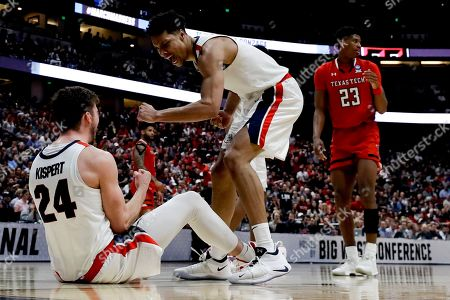 Gonzaga forward Corey Kispert, left, and guard Alex Martin celebrate during the second half of the team's West Regional final against Texas Tech in the NCAA men's college basketball tournament, in Anaheim, Calif
