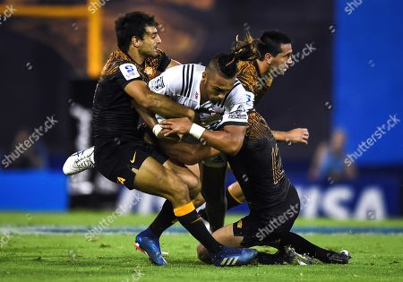 Sean Wainui of Chiefs (C) is marked by Jeronimo de la Fuente, Felipe Ezcurra and Santiago Gonzalez Iglesias of Jaguares in a Super Rugby match played at the Jose Amalfitani stadium, Velez Sarfield, in Buenos Aires, Argentina, 30 March 2019.