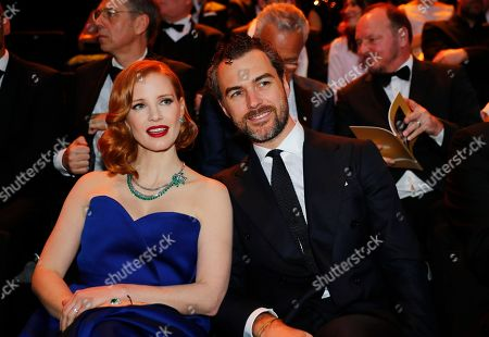 "Jessica Chastain and her husband, Gian Luca Passi de Preposulo, attend the annual ""Golden Camera"" German film and television awards in the decommissioned Berlin Tempelhof Airport. (Hannibal Hanschke/Pool via AP)"