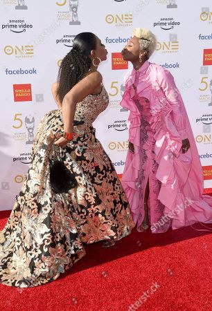 Sheryl Lee Ralph, Cynthia Erivo. Sheryl Lee Ralph, left, and Cynthia Erivo kiss as they arrive at the 50th annual NAACP Image Awards, at the Dolby Theatre in Los Angeles