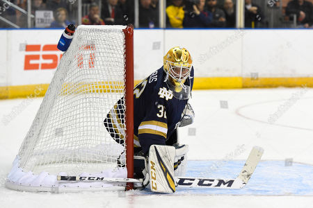 Notre Dame Fighting Irish goaltender Cale Morris (32) protects the net during the NCAA Northeast Regional Championship ice hockey game between the Notre Dame Fighting Irish and the Massachusetts Minutemen held at the SNHU Arena in Manchester NH. UMass defeats Notre Dame 4-0