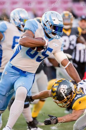 Salt Lake Stallions tight end Nick Truesdell (85) runs upfield past the diving tackle of San Diego Fleet defensive back Xavier Coleman (36) in the first half during an Alliance of American Footaball game, in Salt Lake City