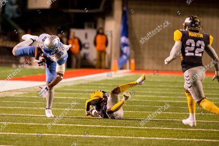 Salt Lake Stallions tight end Nick Truesdell (85) makes a catch past the diving San Diego Fleet defensive back's Kendall James (37) and Jordan Martin (22) in the second half during an Alliance of American Footaball game, in Salt Lake City