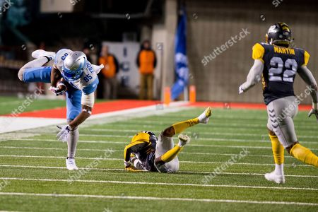 Salt Lake Stallions tight end Nick Truesdell (85) is tackled by San Diego Fleet defensive back Kendall James (center) in the second half during an Alliance of American Football game, in Salt Lake City
