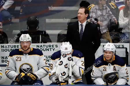 Buffalo Sabres head coach Phil Housley, top, Sam Reinhart (23), Zemgus Girgensons (28) and Kyle Okposo (21) react during the third period of an NHL hockey game against the New York Islanders, in Uniondale, N.Y