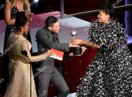 "Malinda Williams, Roshon Fegan, Tracee Ellis Ross. Malinda Williams, from left, and Roshon Fegan present Tracee Ellis Ross with the award for outstanding actress in a comedy series for ""black-ish"" at the 50th annual NAACP Image Awards, at the Dolby Theatre in Los Angeles"