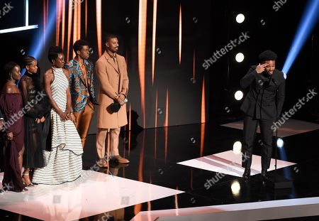 """Ryan Coogler, right, and the cast of """"Black Panther,"""" accept the award for outstanding motion picture at the 50th annual NAACP Image Awards, at the Dolby Theatre in Los Angeles"""