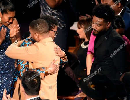 """Chadwick Boseman, Michael B. Jordan, Ryan Coogler. Chadwick Boseman, left, winner of the outstanding actor in a motion picture award for """"Black Panther"""" and Michael B. Jordan embrace as director Ryan Coogler, right, looks on at the 50th annual NAACP Image Awards, at the Dolby Theatre in Los Angeles"""