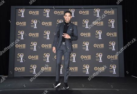 Roshon Fegan poses in the press room at the 50th annual NAACP Image Awards, at the Dolby Theatre in Los Angeles