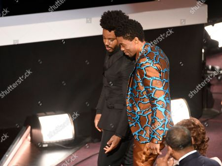 """Ryan Coogler, Chadwick Boseman. Director Ryan Coogler, left, and Chadwick Boseman walk on stage to accept the award for outstanding motion picture for """"Black Panther"""" at the 50th annual NAACP Image Awards, at the Dolby Theatre in Los Angeles"""