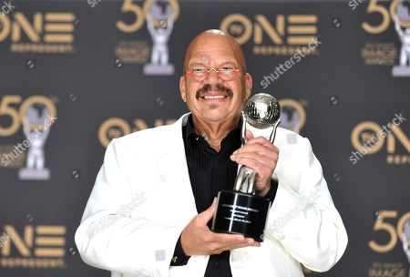 Tom Joyner, winner of the Vanguard award, poses in the press room at the 50th annual NAACP Image Awards, at the Dolby Theatre in Los Angeles