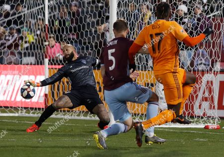 Tim Howard, Alberth Elis, Tommy Smith, tim howard, alberth elis, tommy smith. Colorado Rapids goalkeeper Tim Howard, left, deflects a shot by Houston Dynamo forward Alberth Elis, front right, as he gets past Colorado defender Tommy Smith in the first half of a MLS soccer match, in Commerce City, Colo