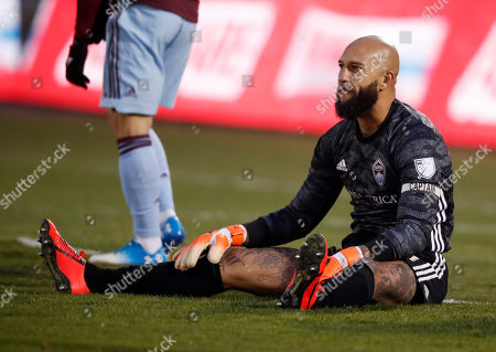 Tim howard, tim howard. Colorado Rapids goalkeeper Tim Howard sits on the pitch after giving up a goal to the Houston Dynamo during the first half of an MLS soccer match, in Commerce City, Colo. Houston won 4-1