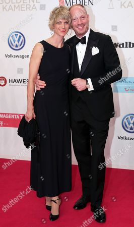 Stock Photo of Johann von Bulow and Katrin von Bulow arrive for the 54th annual 'Goldene Kamera' (Golden Camera) film and television award ceremony in Berlin, Germany, 30 March 2019.