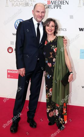 Bibiana Beglau (R) and Goetz Schubert arrive for the 54th annual 'Goldene Kamera' (Golden Camera) film and television award ceremony in Berlin, Germany, 30 March 2019.