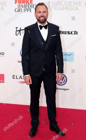 German-American TV host Steven Gaetjen arrives for the 54th annual 'Goldene Kamera' (Golden Camera) film and television award ceremony in Berlin, Germany, 30 March 2019.