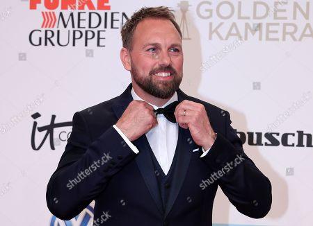 Stock Image of German-American TV host Steven Gaetjen arrives for the 54th annual 'Goldene Kamera' (Golden Camera) film and television award ceremony in Berlin, Germany, 30 March 2019.
