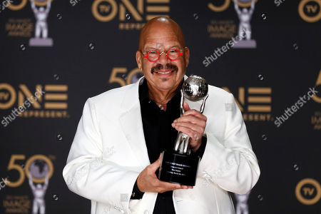 Stock Image of Chairman's Award, and radio personality Tom Joyner, who received the Vanguard Award poses during the 50th NAACP Image Awards at the Dolby Theatre in Hollywood, California, USA, 30 March 2019. The NAACP Image awards honor excellence in television, recording and motion picture categories.
