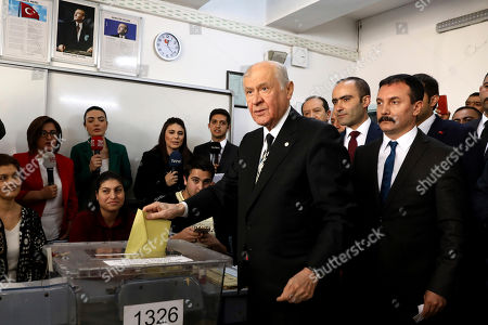 Stock Picture of Chairman of the Nationalist Movement Party MHP Devlet Bahceli casts his ballot at a polling station in Ankara, Turkey, . Turkish citizens have begun casting votes in municipal elections for mayors, local assembly representatives and neighborhood or village administrators that are seen as a barometer of Erdogan's popularity amid a sharp economic downturn