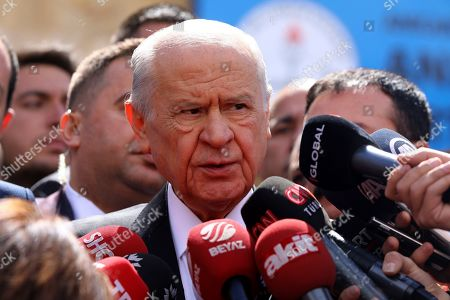 Stock Image of Chairman of the Nationalist Movement Party MHP Devlet Bahceli talks to the media after casts his ballot at a polling station in Ankara, Turkey, . Turkish citizens have begun casting votes in municipal elections for mayors, local assembly representatives and neighborhood or village administrators that are seen as a barometer of Erdogan's popularity amid a sharp economic downturn
