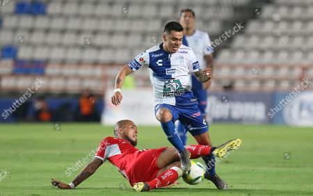 Stock Picture of Pachucas' Emmanuel Garcia (R) vies for the ball with Jonatan Maidana (L) of Toluca during a Mexican league match held at the Hidalgo stadium in Pachuca, Mexico, 30 March 2019.