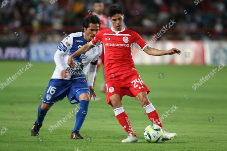 Stock Image of Pachucas' Jorge Hernandez (L) vies for the ball with Pablo Barrientos (R) of Toluca during a Mexican league match held at the Hidalgo stadium in Pachuca, Mexico, 30 March 2019.