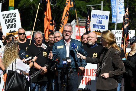 Tony Sheldon (C) speaks to the media as truck drivers form a convoy protest in Sydney, Australia, 31 March 2019. Hundreds of drivers and their supporters took part in trucking convoys in all capitals cities to highlight the need for changes in the industry.
