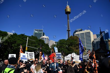 Stock Photo of Tony Sheldon (C) speaks to the media as truck drivers form a convoy protest in Sydney, Australia, 31 March 2019. Hundreds of drivers and their supporters took part in trucking convoys in all capitals cities to highlight the need for changes in the industry.
