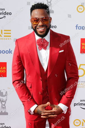 Raheem DeVaughn poses for the photographers upon his arrival for the 50th NAACP Image Awards at the Dolby Theatre in Hollywood, California, USA, 30 March 2019 (issued 31 March 2019). The NAACP Image awards honor excellence in television, recording and motion picture categories.