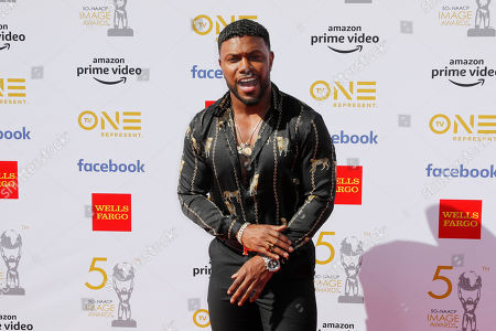 Stock Image of Milan Christopher poses for the photographers upon his arrival for the 50th NAACP Image Awards at the Dolby Theatre in Hollywood, California, USA, 30 March 2019 (issued 31 March 2019). The NAACP Image awards honor excellence in television, recording and motion picture categories.