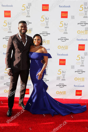 Sinqua Walls (L) and Naturi Naughton pose for the photographers upon their arrival for the 50th NAACP Image Awards at the Dolby Theatre in Hollywood, California, USA, 30 March 2019 (issued 31 March 2019). The NAACP Image awards honor excellence in television, recording and motion picture categories.
