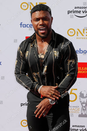 Stock Picture of Milan Christopher poses for the photographers upon his arrival for the 50th NAACP Image Awards at the Dolby Theatre in Hollywood, California, USA, 30 March 2019 (issued 31 March 2019). The NAACP Image awards honor excellence in television, recording and motion picture categories.